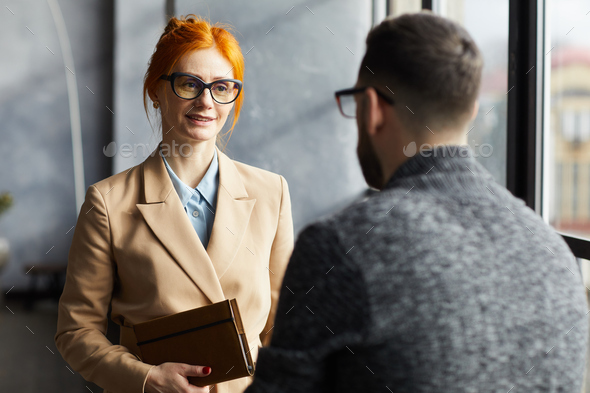 Businesswoman talking to businessman - Stock Photo - Images