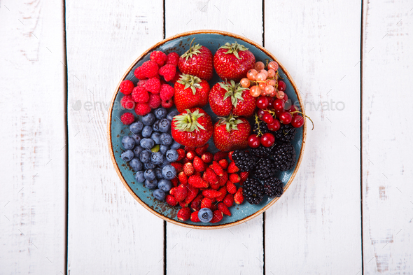 Various Fresh Summer Berries on a white Background.F - Stock Photo - Images