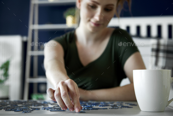 Woman spending time on doing some puzzle game - Stock Photo - Images
