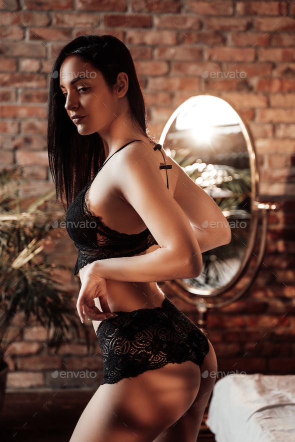 Gorgeous young caucasian woman posing in a luxury flat wearing sexy lace lingerie - Stock Photo - Images