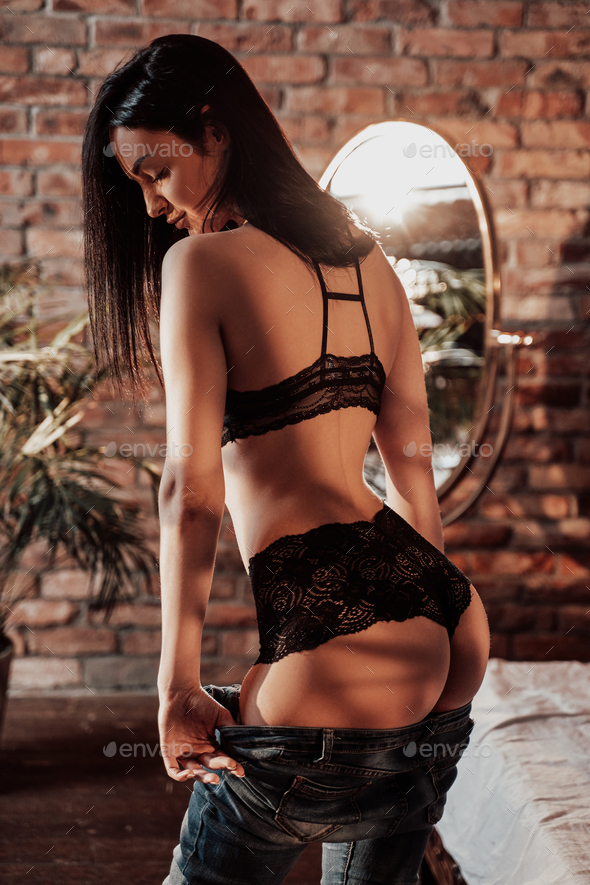Attractive young caucasian woman posing in a luxury flat wearing sexy lace lingerie - Stock Photo - Images