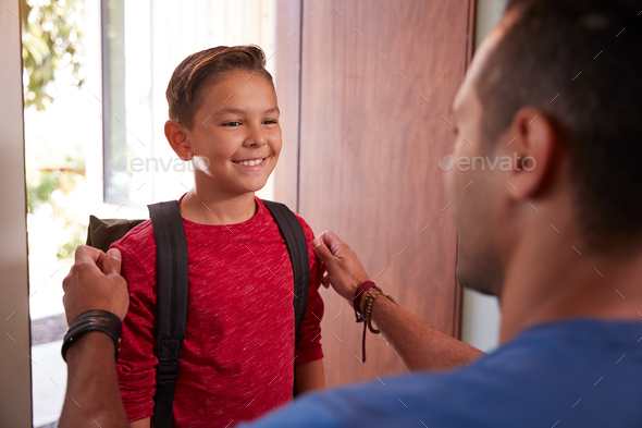 Father Saying Goodbye To Son As He Leaves Home For School - Stock Photo - Images