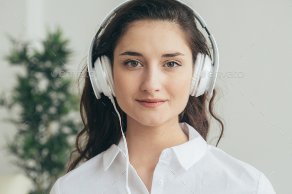 Woman listening music, girl in headphones white portrait
