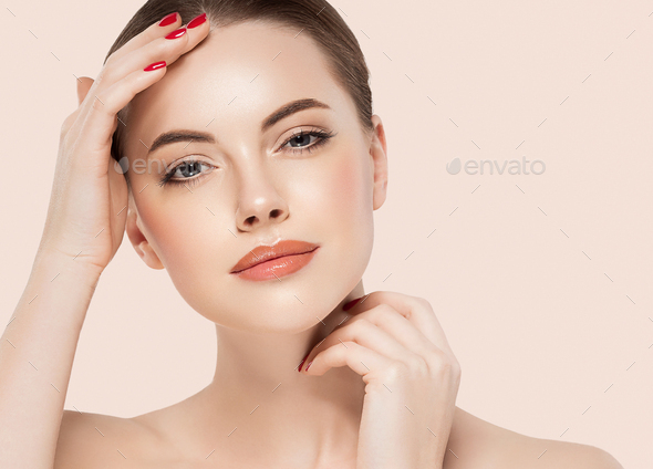Beauty woman healthy skin concept natural makeup beautiful girl face hands touching manicure nails - Stock Photo - Images