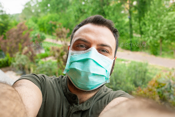 Man making a selfie with surgical mask. - Stock Photo - Images