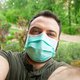 Man making a selfie with surgical mask. - PhotoDune Item for Sale