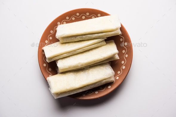 Pootharekulu is a popular paper thin sweet recipe originated from Andhra Pradesh, India - Stock Photo - Images