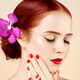 Beautiful woman portrait with perfect makeup flower hair and red lips nails manicure isolated white - PhotoDune Item for Sale