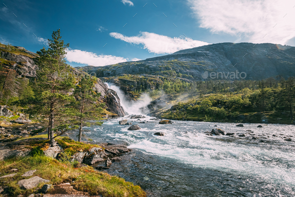 Kinsarvik, Hordaland, Norway. Waterfall Nykkjesoyfossen In Hardangervidda Mountain Plateau. Summer - Stock Photo - Images