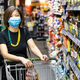 Asian woman shopping groceries in supermarket with protective face mask as new normal requirement - PhotoDune Item for Sale