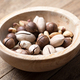 Dried mixed nuts in wooden bowl closeup - PhotoDune Item for Sale