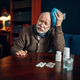 Sick elderly man puts ice on his head, headache - PhotoDune Item for Sale