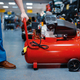 Worker choosing pneumatic compressor in tool store - PhotoDune Item for Sale