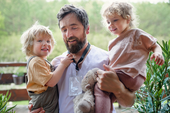 Father doctor finally at home meeting his children, end of coronavirus - Stock Photo - Images