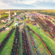 Aerial view of colorful freight trains. Railway station - PhotoDune Item for Sale