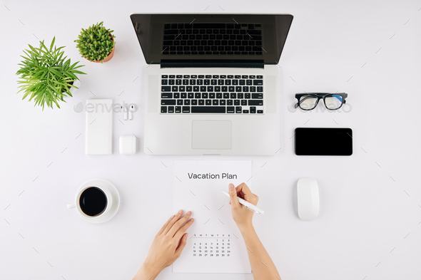 Businesswoman planning vacation - Stock Photo - Images