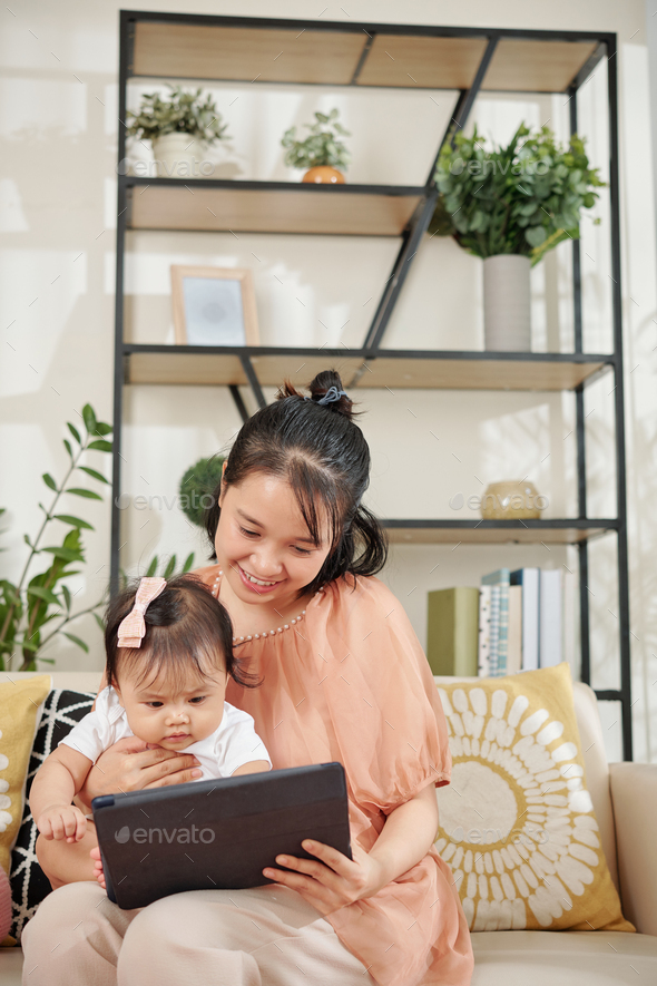 Mother and daughter playing game - Stock Photo - Images