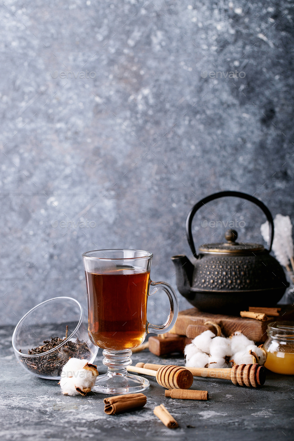 A black metal teapot and a cup of tea in glass cup - Stock Photo - Images