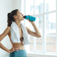 Contemporary Young Woman Drinking Water after Workout - PhotoDune Item for Sale