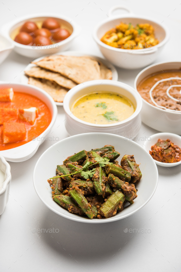 Indian assorted vegetarian food in plate and serving bowls - Stock Photo - Images