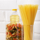 Raw pastas in glass jars and cooking oil on pantry shlelf - PhotoDune Item for Sale