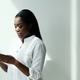 Black Woman Using Smartphone To Send Text Message - PhotoDune Item for Sale