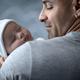 Happy father with newborn baby - PhotoDune Item for Sale