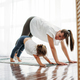 Happy mom and little daughter doing morning exercise together - PhotoDune Item for Sale