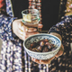 Woman holding dates and water for Ramazan Iftar meal - PhotoDune Item for Sale