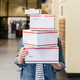 Woman Holding Shipping Boxes in Store - PhotoDune Item for Sale