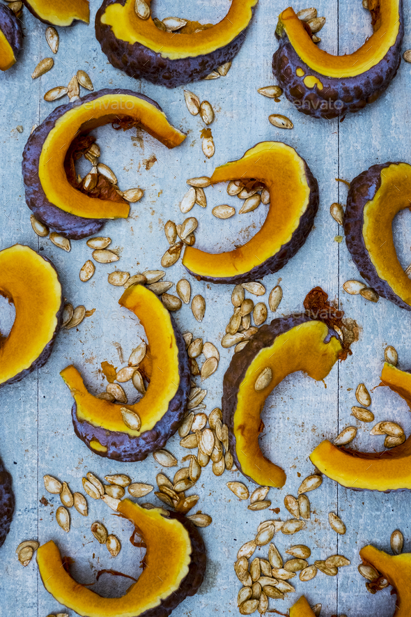 High angle close up of slices of pumpkin on blue background. - Stock Photo - Images