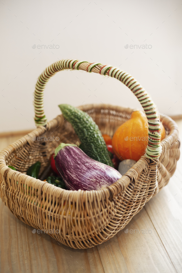 High angle close up of basket with fresh vegetables. - Stock Photo - Images