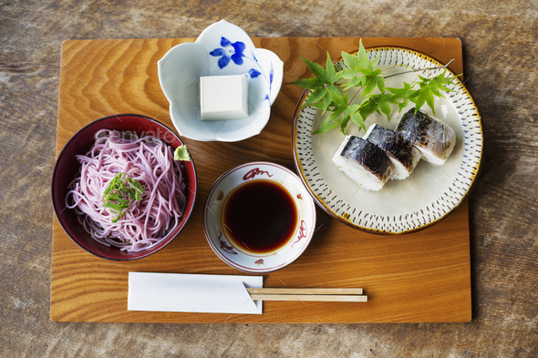 High angle close up of Sushi, Tofu, Noodles and Soy Sauce on a table in Japanese restaurant. - Stock Photo - Images