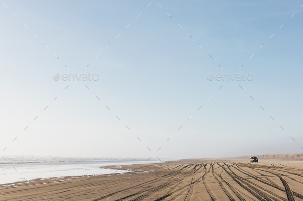 Tire tracks on the soft surface of sand on a beach. - Stock Photo - Images