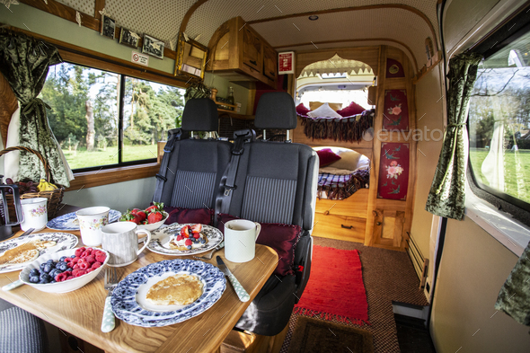 Interior view of camper van with breakfast on table. - Stock Photo - Images