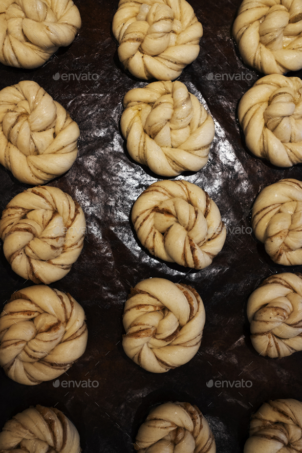 High angle close up of tray with cinnamon buns in an artisan bakery. - Stock Photo - Images