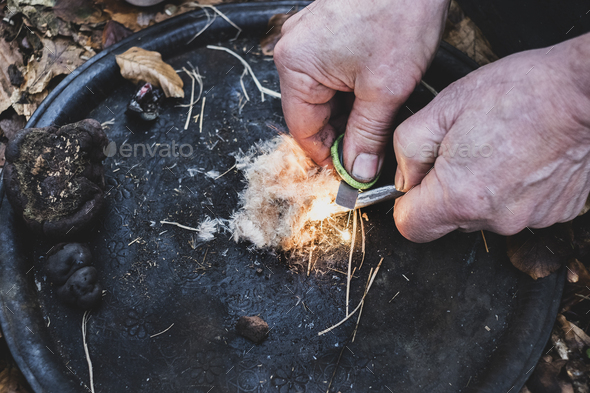 High angle close up of person igniting tinder to start a campfire. - Stock Photo - Images