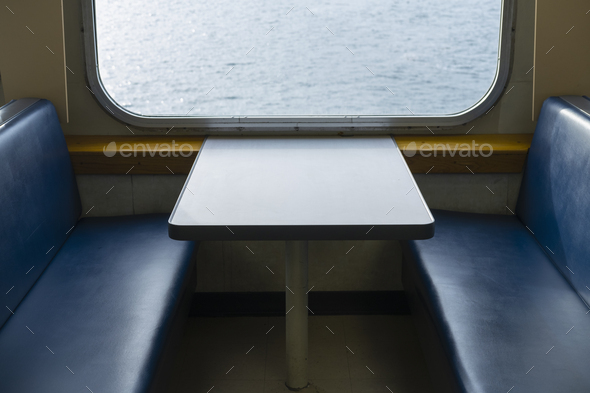 Interior of passenger ferry boat and view over the waters of Puget Sound. - Stock Photo - Images