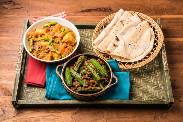 Bhindi masala, ladies finger fry & Mixed veg served with Indian roti - Stock Photo - Images