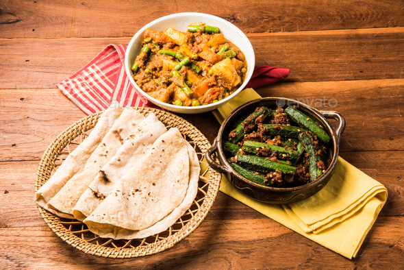 Bhindi masala, ladies finger fry & Mixed veg served with Indian roti - Stock Photo - Images