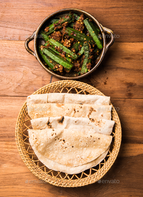 Indian masala fried Okra / bhindi or ladyfinger curry served with chapati - Stock Photo - Images