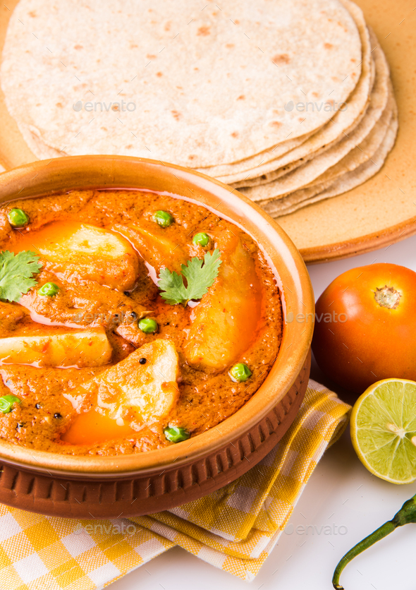 Potato curry, aloo or Aaloo masala fry with green peas, indian food - Stock Photo - Images