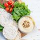 Healthy Snack from Rice Cakes with Hummus, Spinach and Tomatoes - PhotoDune Item for Sale