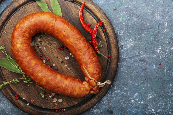 Smoked sausage on grey kitchen table - Stock Photo - Images