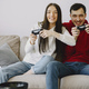 Couple at home playing in a video games - PhotoDune Item for Sale