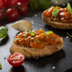 Bruschetta topped with different vegetables on slate - PhotoDune Item for Sale