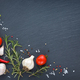 Fresh cherry tomatoes, garlic, salt, pepper and sprigs of rosemary on a black slate board, top view - PhotoDune Item for Sale