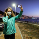 Caucasian woman wearing a protective mask against coronavirus, taking a picture in the streets - PhotoDune Item for Sale