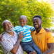 Senior African American man spending time with his son and his grandson in the garden - PhotoDune Item for Sale