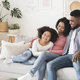 Modern Black Family With Little Daughter Spending Time At Home Together - PhotoDune Item for Sale
